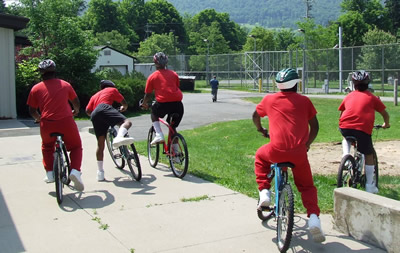 """Residents of Youth Leadership Academy (YLA) are shown ready for a ride on the """"almost new"""" mountain bikes donated by Community Bikes."""