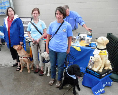 From left to right:  Becky Barnes with guide Lawson, Rachel Silverman with pup on program Malloy and Dianne Martin with pup on program Rio.