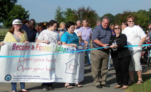 Commissioner Carrión joins Albany County officials in cutting the ribbon to start the Third Annual Foster Care Awareness Walk held at The Crossings of Colonie.